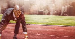 Composite image of close up of businessman in starting blocks stock photo