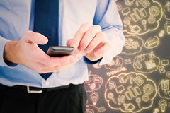 Composite image of close up of a businessman using a smartphone Stock Photography