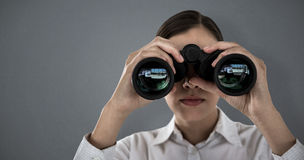 Composite image of close up of businesswoman looking through binoculars Stock Photography