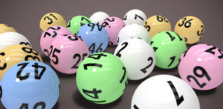 Composite image of close-up on colourful lottery balls Royalty Free Stock Images