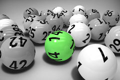 Composite image of close-up on colourful lottery balls. Close-up on colourful lottery balls against grey background Stock Photos