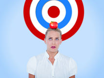 Composite image of close-up of confused businesswoman. Close-up of confused businesswoman  against blue background Royalty Free Stock Photography