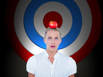 Composite image of close-up of confused businesswoman. Close-up of confused businesswoman  against red and blue target Royalty Free Stock Image