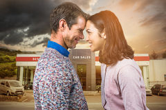 Composite image of close-up of couple standing face to face Royalty Free Stock Photo
