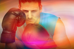 Composite image of close-up of a determined male boxer focused on training Stock Image