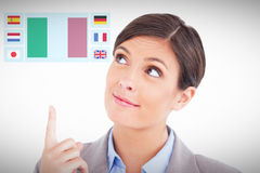 Composite image of close up of female entrepreneur pointing and looking up Royalty Free Stock Photos