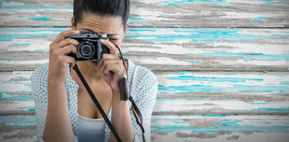 Composite image of close up of female photographer taking picture royalty free stock photo