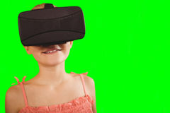 Composite image of close-up of girl wearing virtual simulator Stock Photography