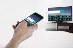 Composite image of close-up of hand holding mobile phone Royalty Free Stock Image