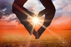 Composite image of close up of hands forming heart Royalty Free Stock Photography