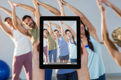 Composite image of close-up of hands holding digital tablet Royalty Free Stock Photo