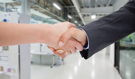 Composite image of close up of a handshake Stock Photo