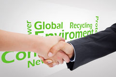 Composite image of close up of a handshake Royalty Free Stock Photo