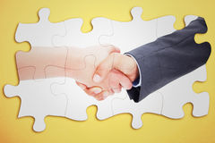 Composite image of close up of a handshake Royalty Free Stock Images