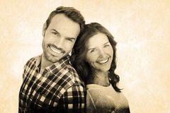 Composite image of close up of happy young couple standing back to back Royalty Free Stock Image