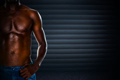 Composite image of close-up mid section of a shirtless muscular man Royalty Free Stock Images