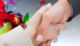 Composite image of close up on new partners shaking hands Stock Photos