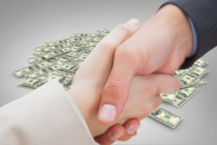 Composite image of close up on new partners shaking hands Royalty Free Stock Images