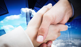 Composite image of close up on new partners shaking hands Stock Images