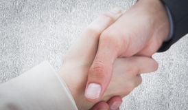 Composite image of close up on new partners shaking hands Stock Image