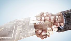 Composite image of close up on partners shaking hands Royalty Free Stock Photo