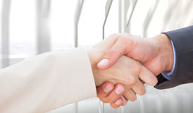 Composite image of close up on partners shaking hands Royalty Free Stock Photography