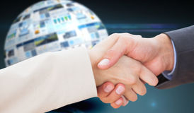 Composite image of close up on partners shaking hands Royalty Free Stock Photos