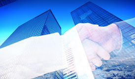 Composite image of close up on partners shaking hands Stock Photo