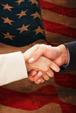 Composite image of close up on partners shaking hands Royalty Free Stock Image