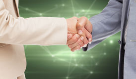 Composite image of close up of people shaking hands Stock Photo