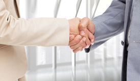 Composite image of close up of people shaking hands Royalty Free Stock Photography