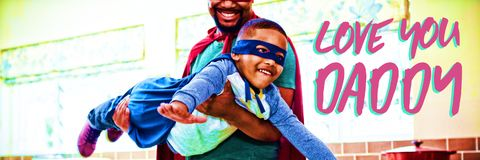 Composite image of close up of pink text love you papa. Close up of pink text love you papa against son and father pretending to be a superhero in kitchen royalty free stock photo