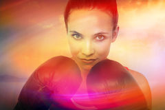 Composite image of close-up portrait of a determined female boxer Royalty Free Stock Photo