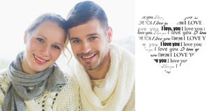 Composite image of close up portrait of a loving couple in winter clothing Stock Image