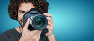 Composite image of close up portrait of male photographer taking picture Royalty Free Stock Photos