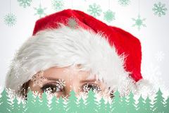 Composite image of close up portrait of pretty woman in santa hat Stock Photography