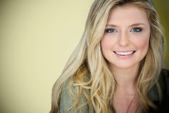 Composite image of close up portrait of smiling young blonde woman royalty free stock photos