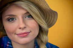 Composite image of close up portrait of smiling young blonde woman Royalty Free Stock Photography