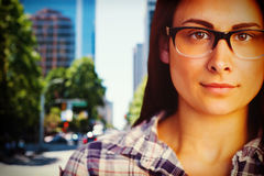 Composite image of close up portrait of young woman wearing eyeglasses Royalty Free Stock Photo