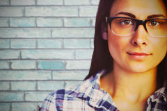 Composite image of close up portrait of young woman wearing eyeglasses Stock Photography