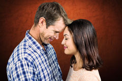 Composite image of close-up of romantic couple standing face to face Stock Photo
