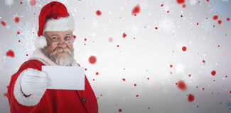 Composite image of close-up of santa claus holding blank paper Royalty Free Stock Images