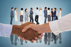 Composite image of close-up shot of a handshake Stock Photo