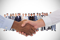 Composite image of close-up shot of a handshake Royalty Free Stock Images
