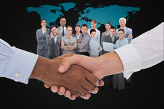 Composite image of close-up shot of a handshake in office Royalty Free Stock Photography