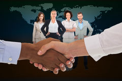 Composite image of close-up shot of a handshake in office Royalty Free Stock Photos