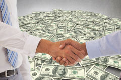 Composite image of close-up shot of a handshake in office Stock Images