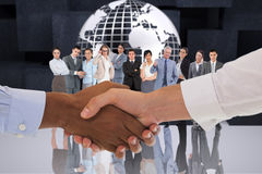 Composite image of close-up shot of a handshake in office Stock Photography