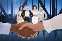 Composite image of close-up shot of a handshake in office Royalty Free Stock Images