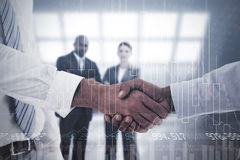 Composite image of close-up shot of a handshake in office Royalty Free Stock Photo